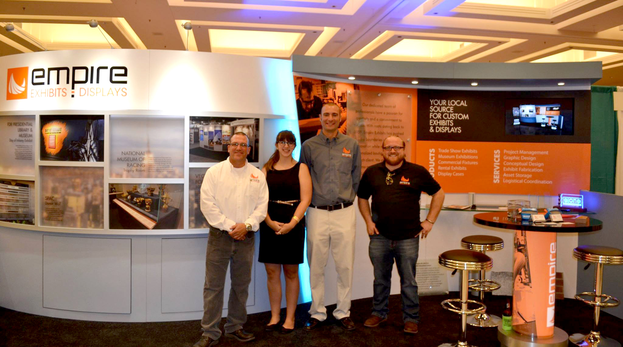 Empire Exhibits Team posing and smiling in trade show booth